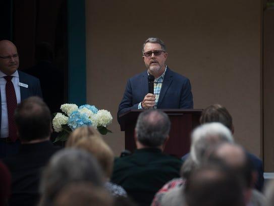 Dr. Eric Leonhardt speaks at the SalusCare  grand