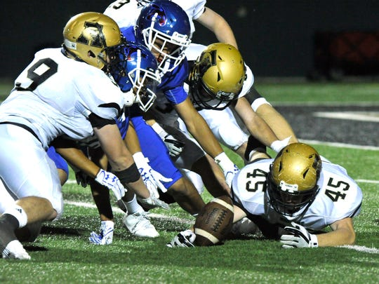 Abilene High and Cooper players scramble to recover a fumble during Friday's crosstown showdown game at Shotwell Stadium Sept. 15, 2017. Cooper won, 49-35, to snap a four-game losing streak to AHS.
