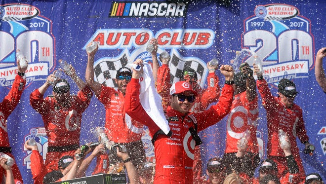 Kyle Larson celebrates after winning the Cup Series race at Auto Club Speedway on March 26, 2017, to compete a weekend sweep at the Southern California track.