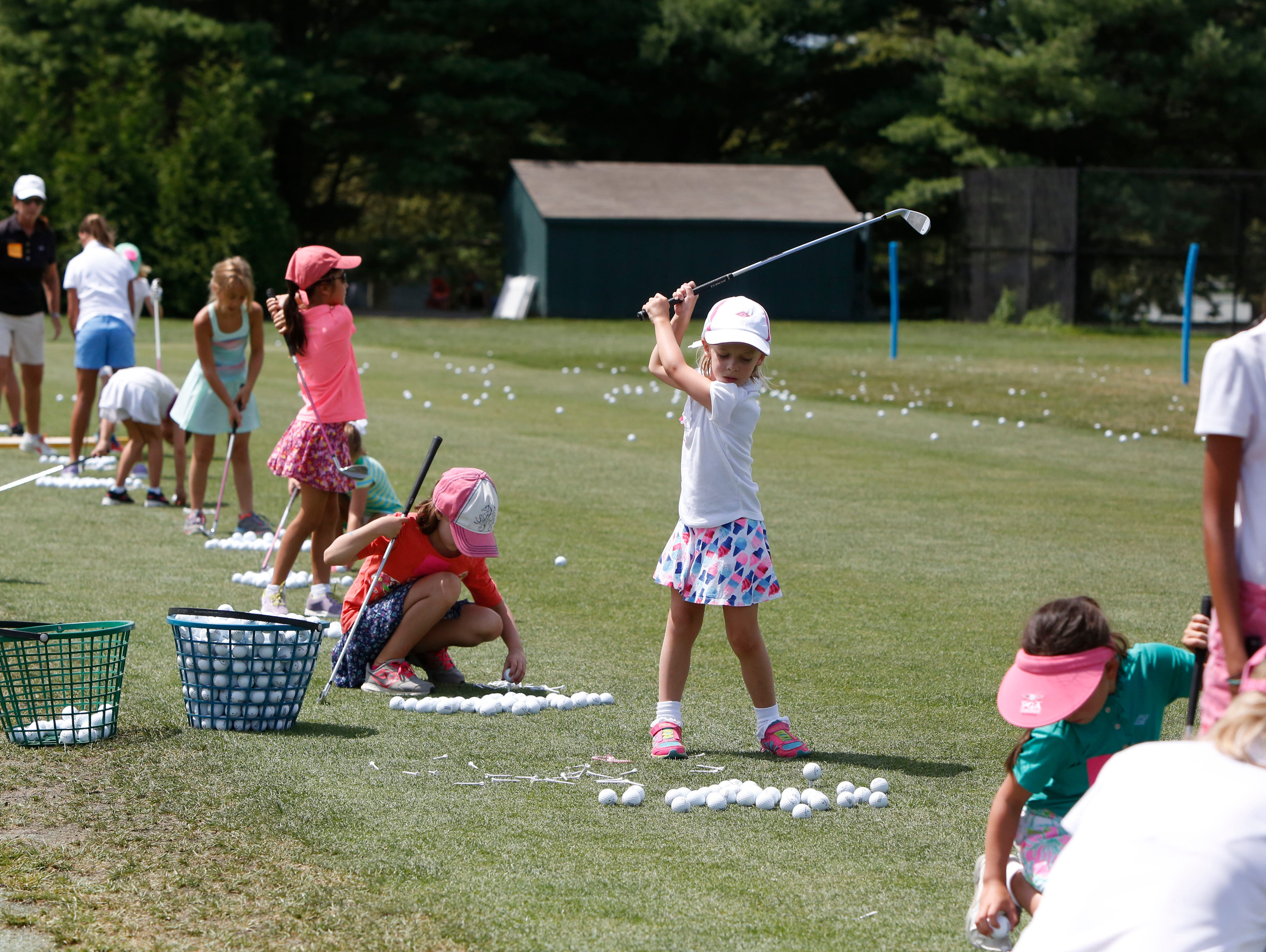 Eloise Schultz, 6, of Rye practices her swing at the Girls to the Tee event put on by the Women's Metropolitan Golf Association at Westchester Country Club in Rye, Aug. 8, 2016. The free clinic, for girls ages 6-18, is an afternoon of instruction and networking to help show girls who are learning the game that they are part of a larger group.