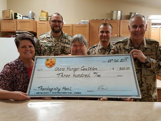 German air force personnel present a check for the