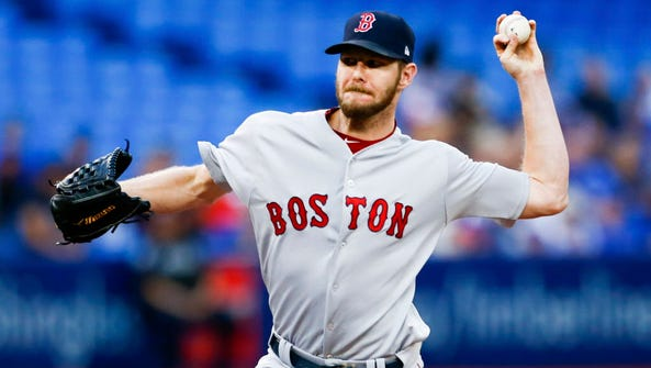Red Sox starting pitcher Chris Sale delivers a pitch