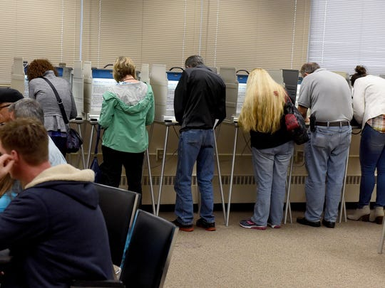 Voters cast their absentee ballots in the Minnehaha