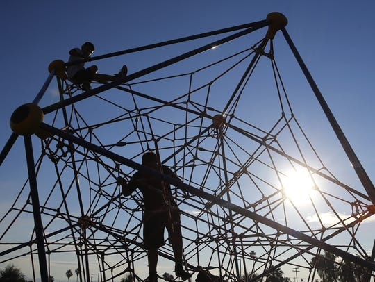 Children play on the playground after hours at Wilson