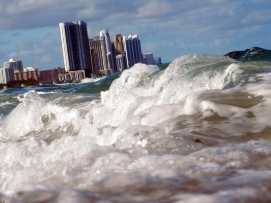 NORTH MIAMI, FL - MARCH 14:  Buildings are seen near the ocean as reports indicate that Miami-Dade County in the future could be one of the most susceptible places when it comes to rising water levels due to global warming on March 14, 2012 in North Miami, Florida. Some cities in the South Florida area are starting to plan for what may be a catastrophic event for the people living within the flooding area..  (Photo by Joe Raedle/Getty Images)
