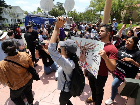 Supporters of the Deferred Action for Childhood Arrivals Act and others demonstrate outside the U.S. District Court 9th Circuit in Pasadena on Tuesday.