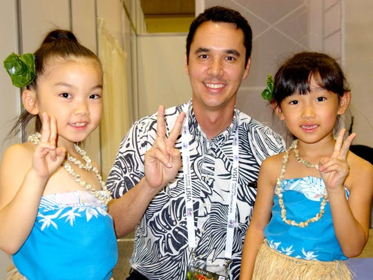 Guam Visitors Bureau President and CEO Nathan Denight with two young dancers, Lino and Nanaka, of the Guam Chamorro Dance Academy at the JATA Tourism Expo in Japan.