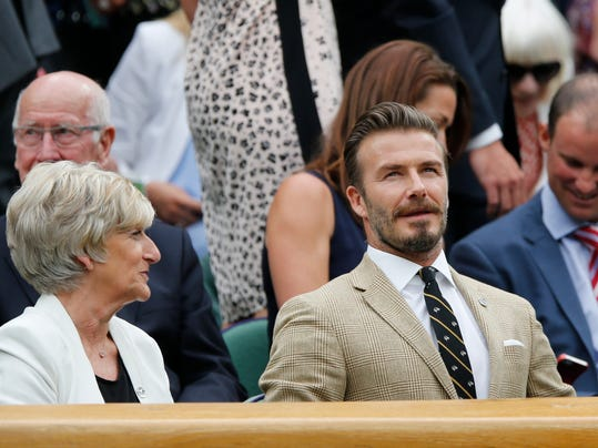 David Beckham, right, and his mother Sandra Beckham, left, sit in the Royal Box on centre court at the All England Lawn Tennis Championships in Wimbledon, London, Saturday, June 28, 2014. (AP Photo/Ben Curtis)