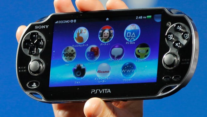 In this Sept. 14, 2011 file photo, Sony Computer Entertainment's PlayStation Vita is shown during a press conference in Tokyo. Sony's long-awaited PlayStation Vita portable game machine hits stores in Japan on Saturday Dec. 17 with the company predicting brisk sales even though the launch has missed much of the holiday shopping season.