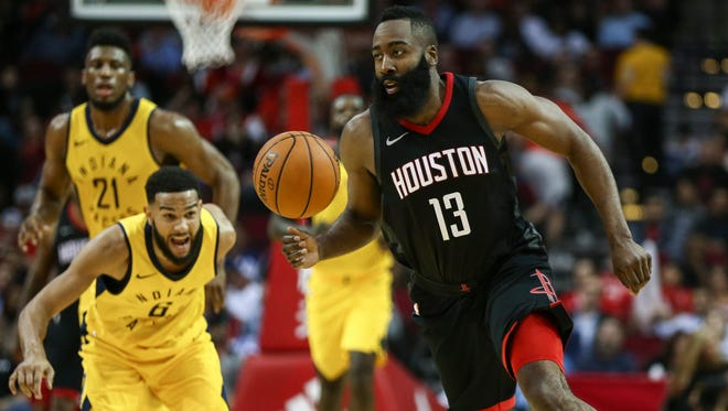 Houston Rockets guard James Harden (13) controls the ball as Indiana Pacers guard Cory Joseph (6) defends during the second quarter at Toyota Center.