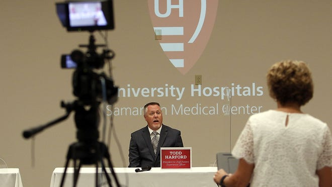 University Hospitals Samaritan Medical Center manager of Communications & Development Kathy Witmer, right, directs a question to Samaritan President Todd Harford at the news conference Thursday held by the hospital to update the community and to answer some questions received from the community on the COVID-19 pandemic.