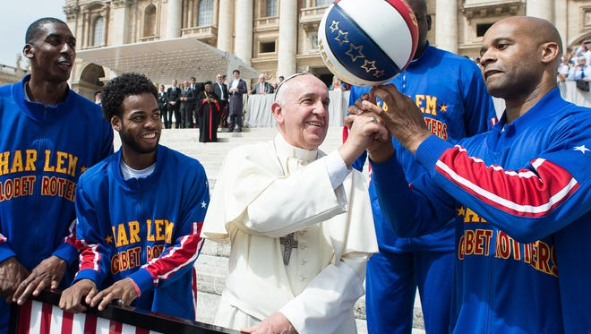 Members of the Harlem Globetrotters with Pope Francis at the Vatican in 2015.