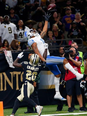 Lions receiver Marvin Jones pulls in a one-handed touchdown over Saints cornerback Ken Crawley in the second half in New Orleans, Sunday, Oct. 15, 2017.