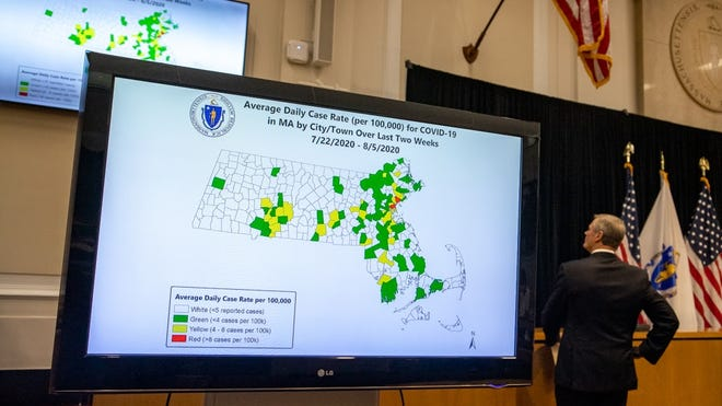 Gov. Charlie Baker looked up at a television screen displaying the state's new color-coded COVID-19 infection rate map during a Tuesday news conference.