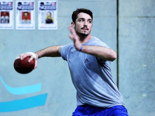 January 22, 2016 — Former University of Memphis quarterback Paxton Lynch runs a drill with arena football players from the Orlando Predators during a workout at D1 Sports in Orlando, FL. Lynch is currently preparing for the NFL combine as he transitions from collegiate student-athlete to a highly-touted draft prospect. (Yalonda M. James/The Commercial Appeal)