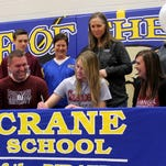 Crane senior Emma Lander (front, center) upheld her commitment to attend Evangel University to play volleyball and compete in track and field with a ceremony at Crane High School Friday, Feb. 5, 2016.