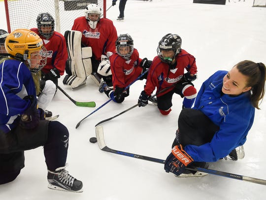 Allie LaCombe coaches young girls at the Breakaway hockey camp for girls at Centennial Sportsplex on Saturday, July 22, 2017, in Nashville.