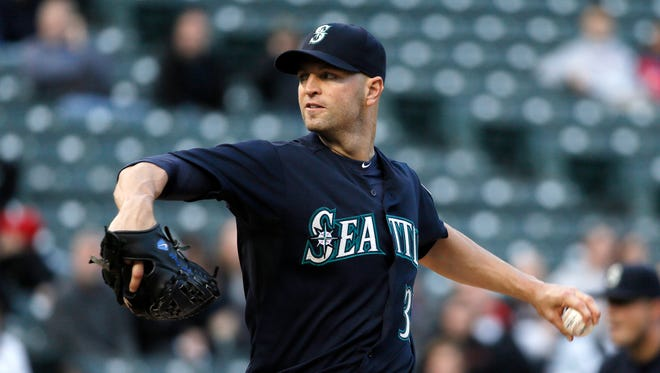 Seattle Mariners' J.A. Happ delivers to the Texas Rangers in the first inning of a baseball game Tuesday, April 28, 2015, in Arlington, Texas.