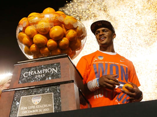 Clemson quarterback Deshaun Watson (4) poses with the Orange Bowl trophy following an NCAA college football semifinal playoff game against Oklahoma, Thursday, Dec. 31, 2015, in Miami Gardens, Fla. Clemson defeated Oklahoma 37-17. (AP Photo/Joe Skipper)