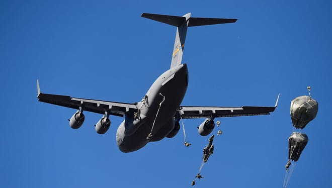 U.S Paratroopers from the 4/25th Infantry Division make a jump from a C-17 Globemaster as part of exercise Talisman Sabre on July 8, 2015 in Rockhampton, Australia.