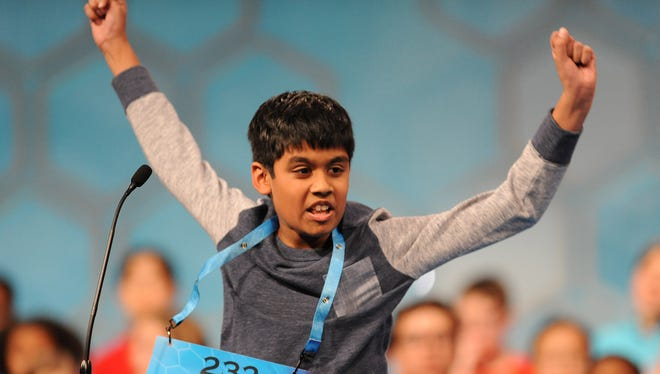 Nihar Janga, 11, of Austin, Texas, reacts after correctly spelling 'quillon' on Thursday, in the finals.