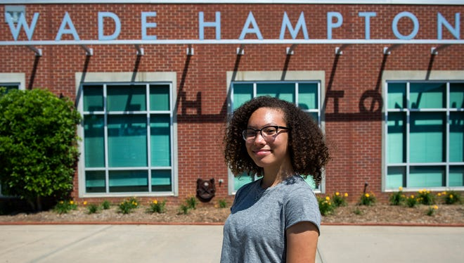 Asha Marie stands in front of the Wade Hampton High School sign on Tuesday, May 16, 2017. Asha Marie started a petition to officially change the school's name after finding out it was named after Wade Hampton, a Confederate general and slaveholder.