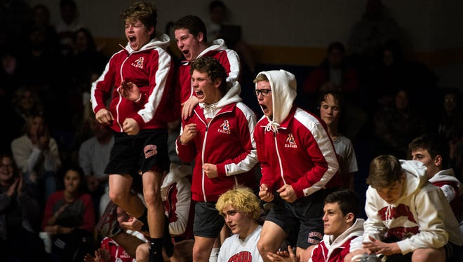 The Bermudian Springs wrestling team reacts as Carter King pins Littlestown's Logan Dickensheets in the second period during the 285-pound match, Wednesday, Dec. 13, 2017. Bermudian Springs beat Littlestown, 69-6.