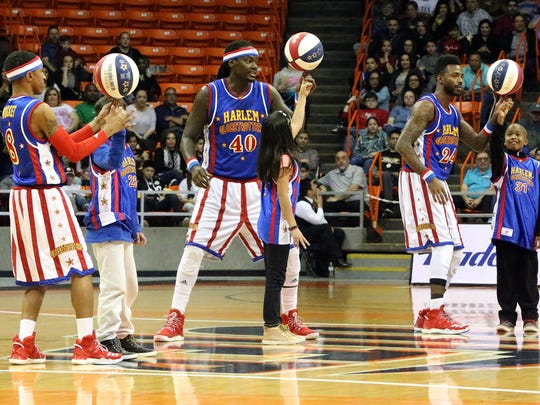 Slick Willie Shaw, 40, and fellow Harlem Globetrotters Rocket Pennington, 8, and Dragon Taylor, 24, help three kids spin the ball on their finger in the middle of their game with the All Stars team in January 2017 in the Don Haskins Center. The famed wizards of basketball stopped by as part of their 2017 World Tour. The team, founded in 1926, has entertained more than 144 million fans in 122 countries and territories, their website states.