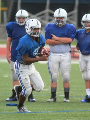 Nelson Perrin will play quarterback for Scott this year after rushing for 746 yards and 10 touchdowns last season.