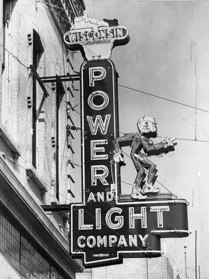 Reddy Kilowatt, an iconic neon sign and mascot for the Wisconsin Power and Light Company is seen here in the 1940s. This was located on the southeast corner of North Eighth Street and Center Avenue.