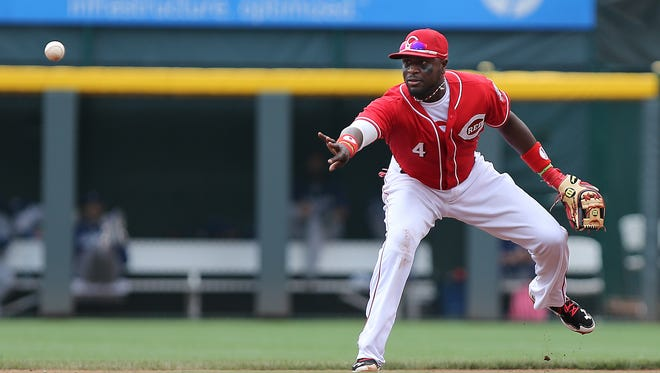 Brandon Phillips tosses the ball to second base for an out as the Cincinnati Reds take on the Los Angeles Dodgers at Great American Ball Park  on Thursday.