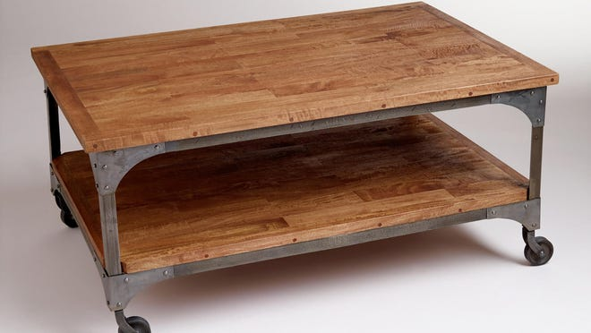 Wood and metal touches take style back in time. Aiden coffee table, $229.99 at Cost Plus World Market.