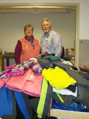 Mona Etter, left, President of the Chambersburg Area Hospital Auxiliary, and John Massimilla, Chief Operating Officer at Chambersburg Hospital, stand among a pile of donated clothing after a three-day clothing drive for the CASHS Clothing Closet.