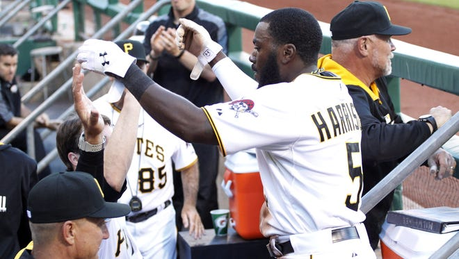 Pirates right fielder Josh Harrison (5) receives a high-five in the dugout at PNC Park.