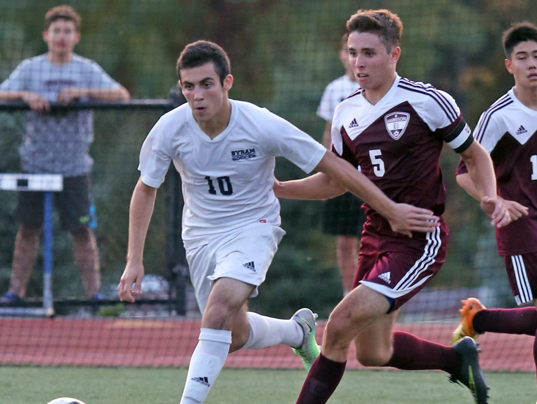 Jack Beer of Byram Hills keeps the ball away from Harrison's Ryan Homem during their game on Monday. Boys soccer beat writer Vin Mercogliano has Beer and the Bobcats winning a section title in Class A.