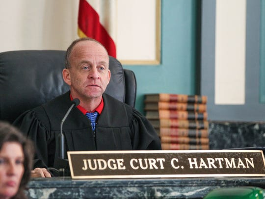 Judge Curt Hartman presides over the trial of Monika