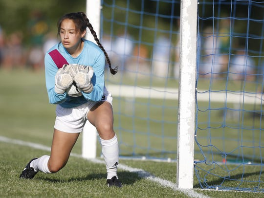 Ankeny Centennial junior goalkeeper Nahomi Lopez (00) snags a Bettendorf shot Thursday, June 8, 2017, during the 3A girls state quarterfinals at the Cownie Sports Complex in Des Moines.