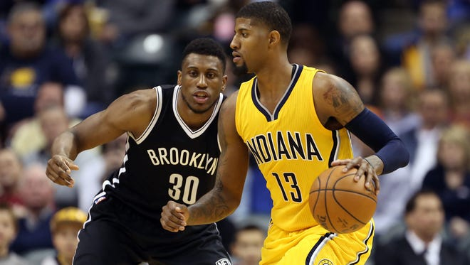 Indiana Pacers forward Paul George (13) is guarded by Brooklyn Nets forward Thaddeus Young (30) at Bankers Life Fieldhouse. Indiana defeats Brooklyn 104-97. Mandatory Credit: Brian Spurlock-USA TODAY Sports
