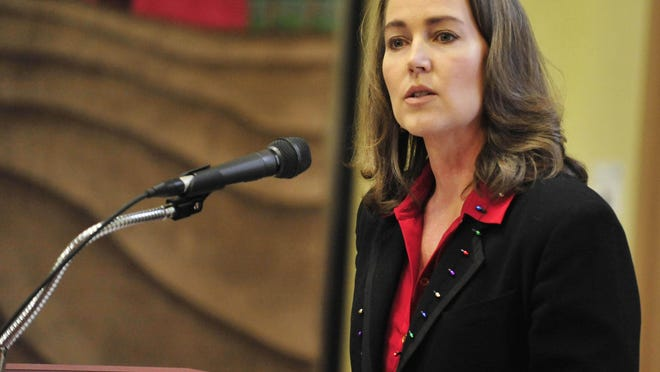 Cylvia Hayes speaks during the Governor's State Employees Food Drive kick-off in December 2014. The Oregonian has placed a lien against her Bend home.