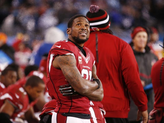 Arizona Cardinals' Patrick Peterson looks at the scoreboard