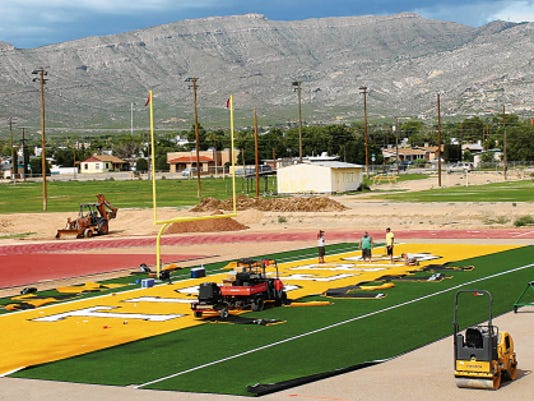 Crews from the Sports Contracting Group installed turf in the northern end zone at Tiger Stadium on Tuesday. Despite the recent rains in the area, the construction is on schedule according to Alamogordo Public Schools Director of Support Services Vance Lee. The first phase of the project includes asphalt resurfacing, on-site fencing and turf installation. First phase is estimated to be completed Aug. 11. The resurfacing of the track will not begin until November or December. Alamogordo's first home game is Aug. 28.
