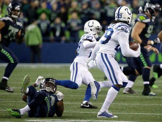 Indianapolis Colts free safety Malik Hooker (29) runs with an interception as Seattle Seahawks running back J.D. McKissic, left, reacts, in the second half of an NFL football game, Sunday, Oct. 1, 2017, in Seattle. (AP Photo/Elaine Thompson)