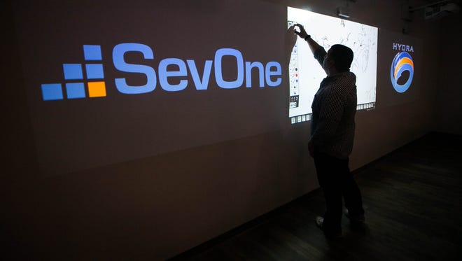 An employee is seen in the Hydra conference room at SevOne's new Innovation and Technology Center at UD's Star Campus.