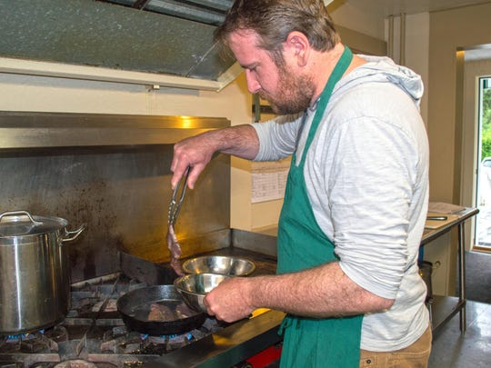 Michael Curcio, a chef from Boston, works with liver