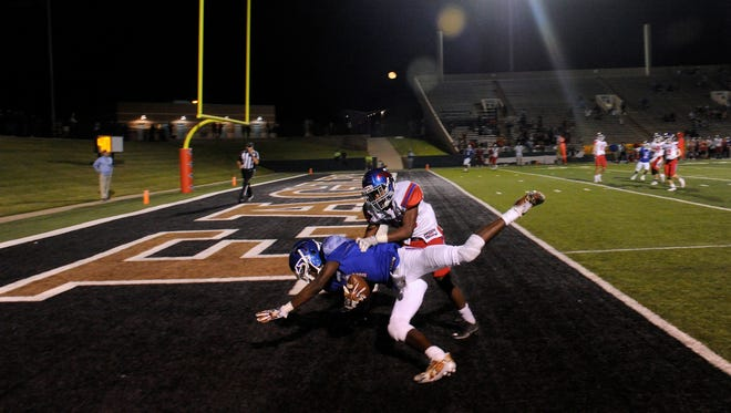 Cooper wide receiver Myller Royals lands in the end zone after catching the game-winning pass during the Cougars' game against Grapevine on Friday. Cooper rallied to wni as Royals set a school record with 15 receptions for 192 yards.