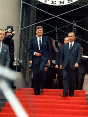 Partly off frame to the left, Secret Service Agent Frank Yeager positions himself as President John F. Kennedy and Governor of West Virginia, William W. Barron, exit the State Capitol Building in Charleston, West Virginia on June 20, 1963. Yeager, who worked in Kennedy's detail from 1961-1963, said the president was a bright and caring man.