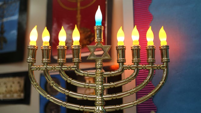 A menorah stands in the classroom of Etti Scheier, who teaches Hebrew at Rockwern Academy in Sycamore Township.