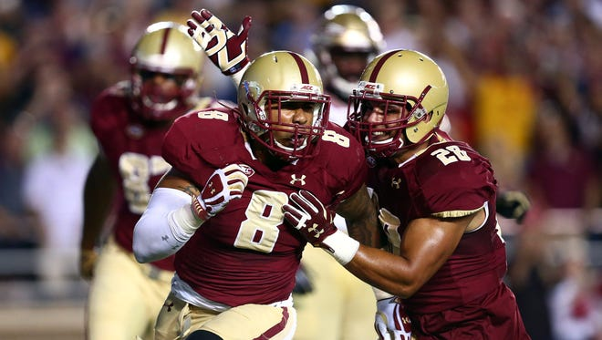 Boston College defensive lineman Harold Landry (8) and linebacker John Lamot (28) hope to pull off a monumental upset over Florida State.