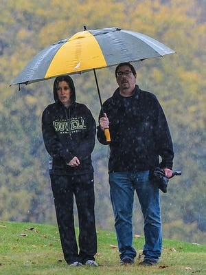 Spectators watch the Greater Lansing Cross Country Championships in a downpour Saturday, Oct. 14, 2017.