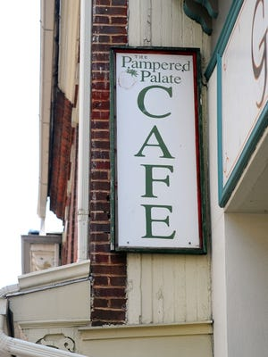 A sign on the side of the building marks the location of The Pampered Palate on East Beverley Street in downtown Staunton.